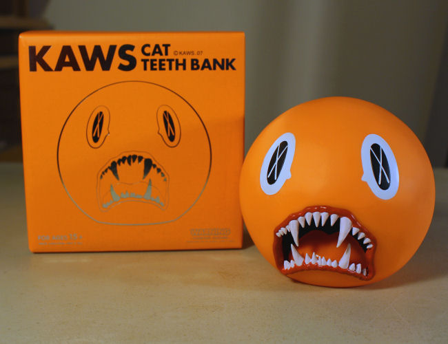 KAWS - Cat Teeth Bank Orange
