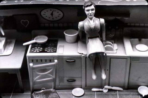 Laurie Simmons - woman kitchen sitting
