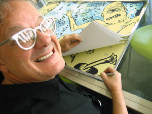Mark Mothersbaugh signing the Drinkin with Cyclops edition